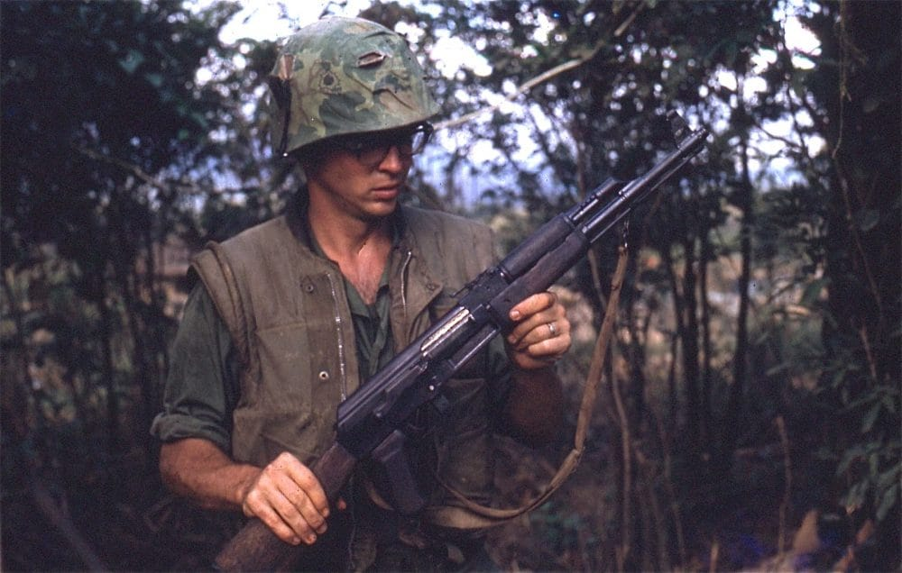 """2d Lt. Robert Drieslein with a captured AK-47, 1968"" (Photo: Marine Corps History Division)"