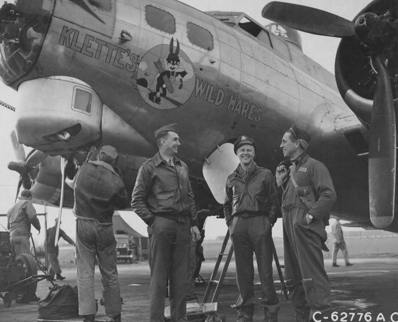 """England. The crew of the 91st Bomb Group, 8th Air Force, relax beside the Boeing B-17 Flying Fortress, Klette's Wild Hares. They have just returned from a bombing attack on enemy territory."" Note the M1911 pistol and holster of the crewmember to the far right. (Photo: U.S Army Air Corps via National Archives)"