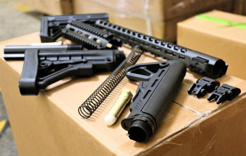 According to CBP, the parts included a mix of sights, stocks, muzzles, brakes, buffer kits, and grips (Photo: CBP)