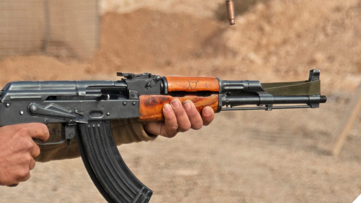 Syrian Democratic Forces soldier fires a Kalashnikov rifle during weapons training in Deir ez-Zor province, Syria, Nov. 29, 2018