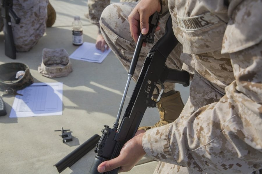 A Marine with Task Force Al-Taqaddum 18.1 Rotation 6 assembles an AK-47 assault rifle as part of a foreign weapons demonstration at Marine Corps Base Camp Pendleton, California, Jan. 16, 2018. The demonstration was done in order to familiarize the Marines with systems they may encounter while deployed overseas. (U.S. Marine Corps photo by Lance Cpl. Robert Bliss)