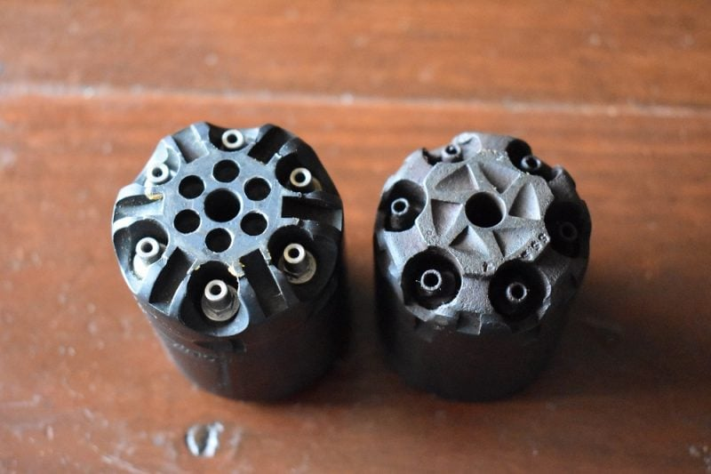 Note the stainless steel nipples set deeply into the cylinder on the Ruger Old Army model, left, compared to the nipples on the vintage Remington New Army, right. This helps prevent bits of fired percussion caps from working their way into the mechanism or behind the cylinder and creating a jam.