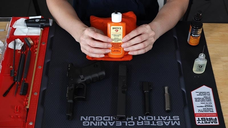 gun oil lube on a cleaning table