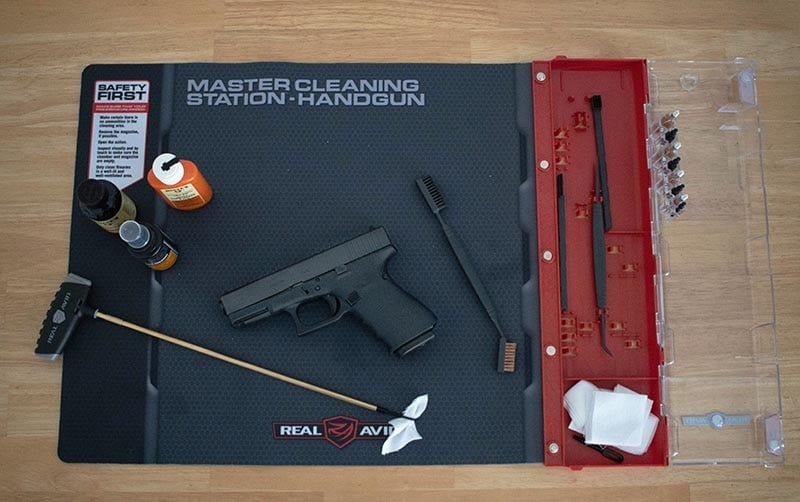 cleaning tools laid out for cleaning a glock