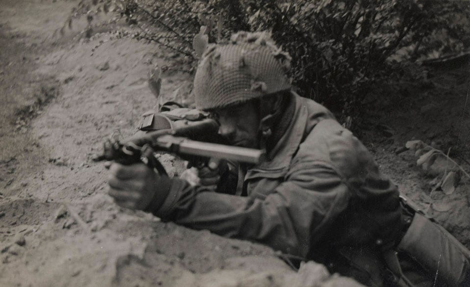 """Private J Connington of Selby, Yorkshire, in action with his Sten gun, 20 September 1944 Market Garden""(Photo: National Army Museum)"