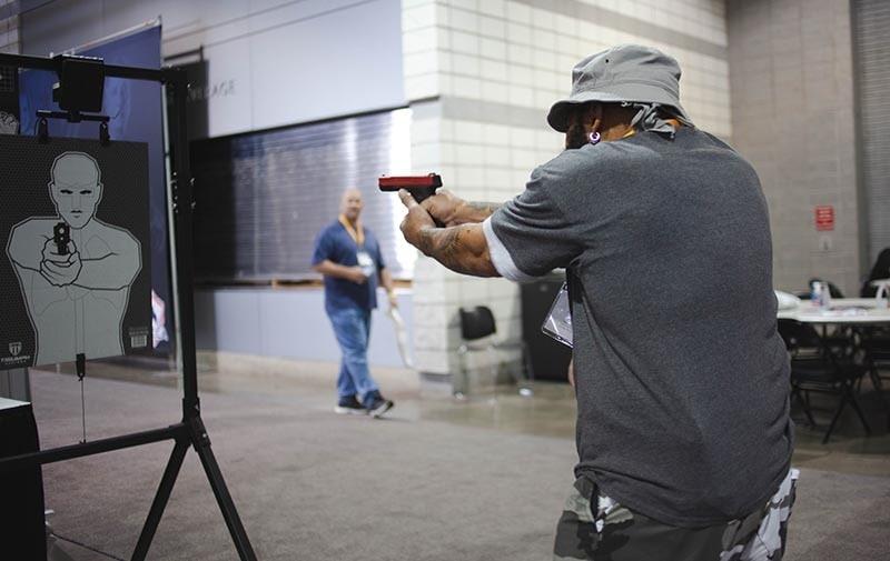 male shooting target at range indoors