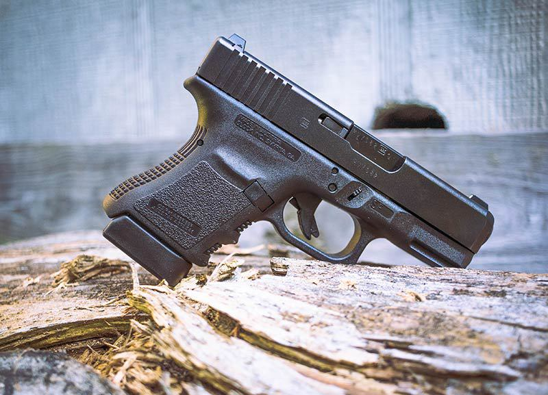 Glock 30 sf on a log outdoors
