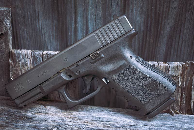 Glock 23 on a piece of lumber