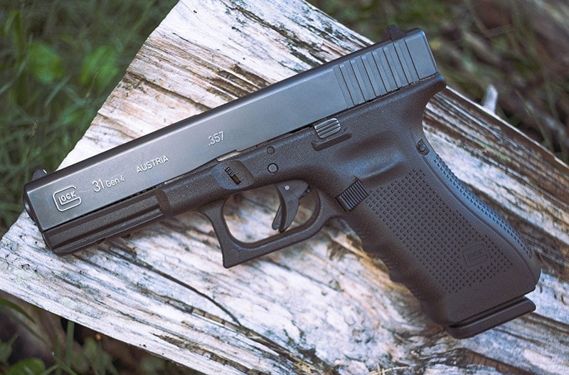 Glock 31 on a log outdoors