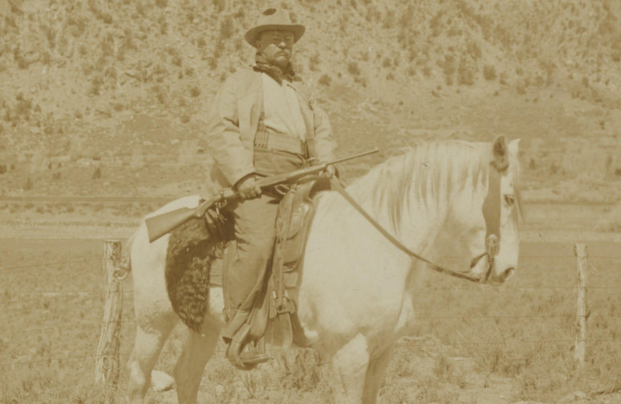 """""""On the great bear hunt President Roosevelt after leaving Newcastle for the mountains, 1905 Colorado."""" Note the Colonel, who was president at the time, is carrying the modified M1903 and is using a Spanish-American War-era military-issue Mills Cartridge belt to hold reloads. (Photo: Library of Congress)"""