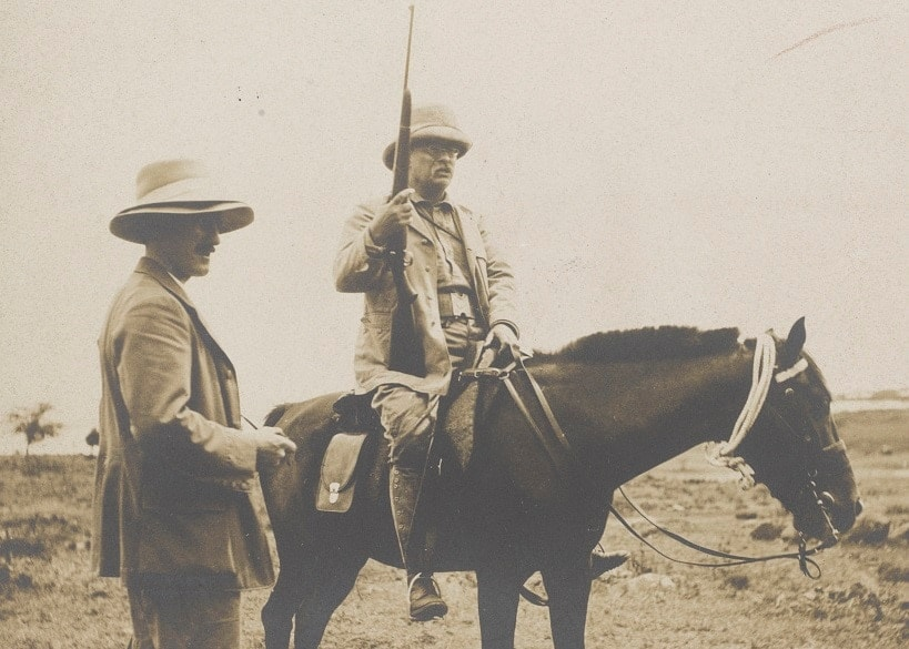 Roosevelt on horseback, holding what looks to be the modified M1903 rifle. The man standing next to him is possibly Kermit Roosevelt. The image was from a 1910 African safari. (Photo: Library of Congress)