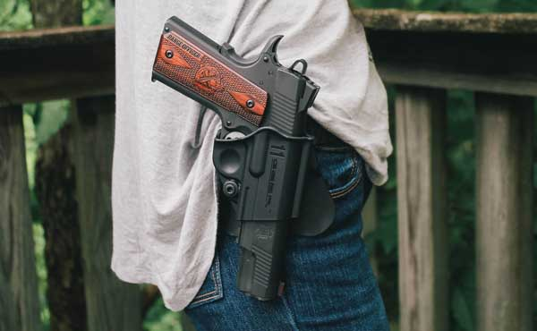 1911 sitting in holster on female wearing jeans