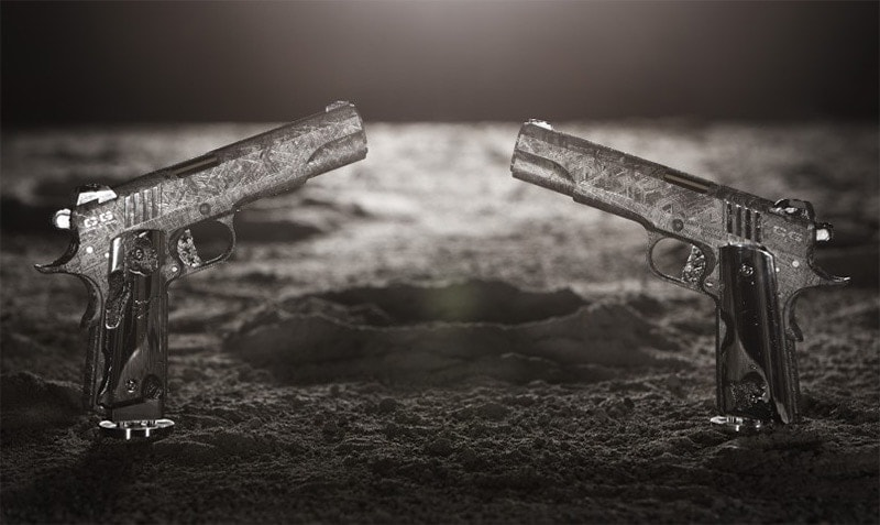 two 1911s facing eachother on artistic dark background