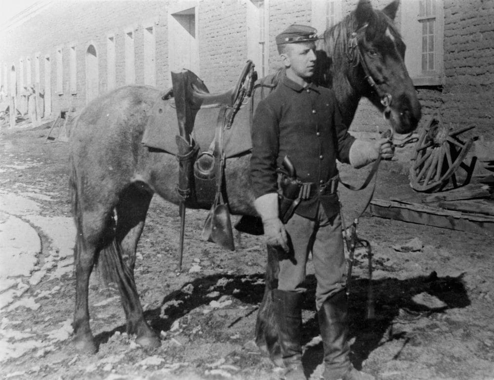 Cavalry Soldier and horse in Mechanics Corral, Fort Union. Note his Colt 1873 SAA (Photo: National Park Service)