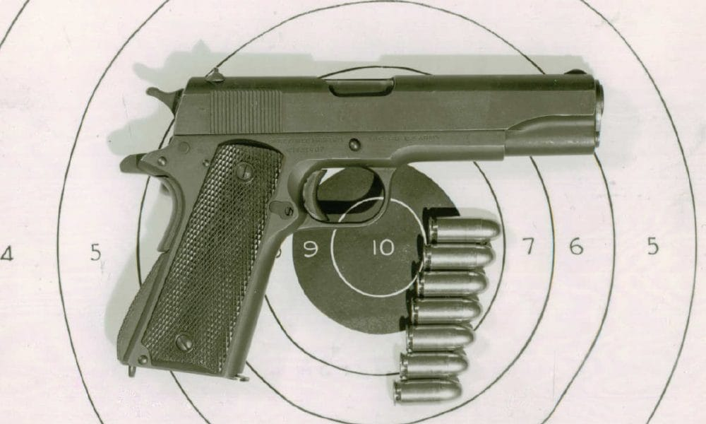Right side view of a Colt M1911A1 pistol, with seven rounds 10972-SA.A.1
