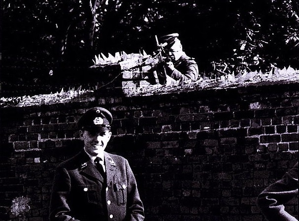 A West German border guard standing just over the line from an East German border guard, the latter armed with a PPsh-41 and a desire to enforce the rules of the People's Republic. (Photo: Library of Congress)