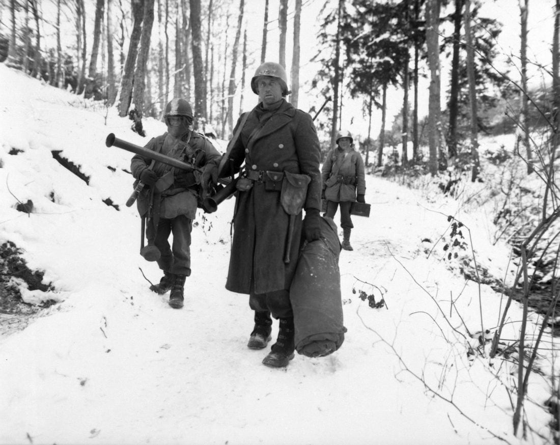 American engineers emerge from the woods and move out of defensive positions after fighting in the vicinity of Bastogne, Belgium, December 1944. Note the M1 Garand, M1 Carbine and M9 Bazookas, along with a liberal sprinkling of grenades and spare ammo. (Photo: U.S. Army)