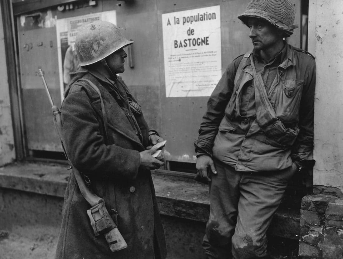Bastogne Belgium-Weary infantrymen of the 110th Regt., 28th Div., US 1st Army following the German breakthrough in that area. The enemy overran their battalion. (L-R) Pvt. Adam H. Davis and T/S Milford A. Sillars. Dec. 19, 1944. Note the M1 Carbines (Photo: National Archives)