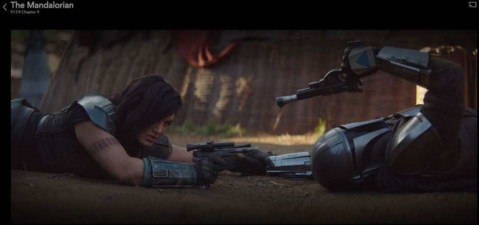 """Cara and the Mandalorian draw their pistols after a brief scuffle in """"Chapter 4: Sanctuary"""" (Photo: IMFDB)"""