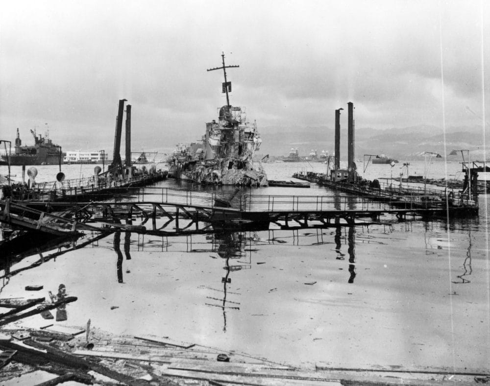 A view inside the drydock, then sunk and full of water, the day after the attack. USS Shaw is seen severely damaged in the center of the dock. (Photo: U.S. Navy)