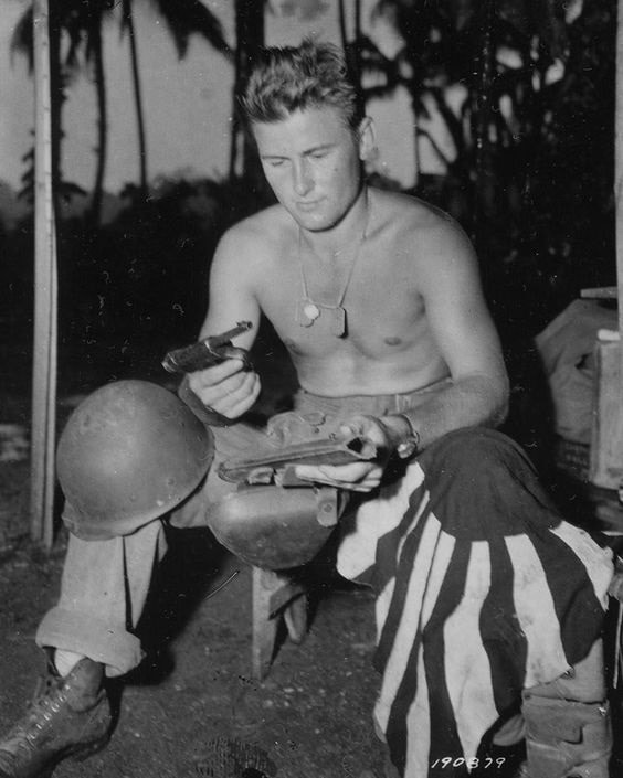 SGT George Chamberlain, Co.K 172nd inf rgt 43rd Inf Div. Silver Star New Georgia in 1943 captured Japanese battle flag and a Type 14 Nambu pistol.