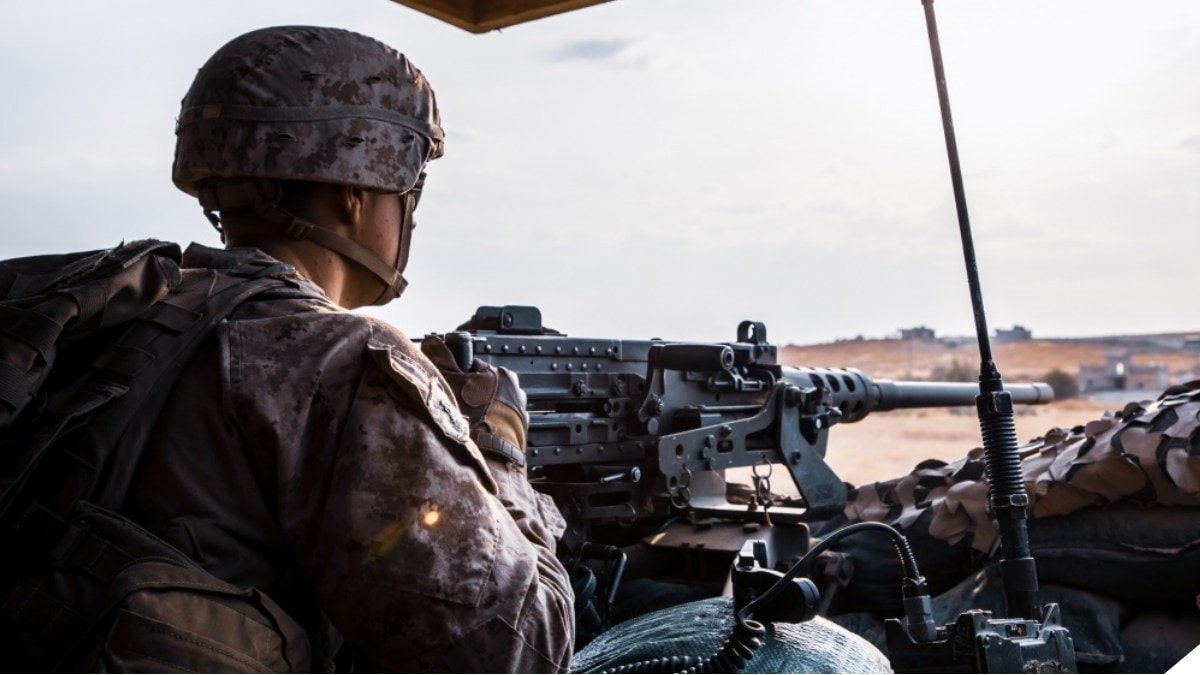 A U.S. Marine with 2nd Battalion, 7th Marines, attached to the Special Purpose Marine Air-Ground Task Force – Crisis Response – Central Command (SPMAGTF-CR-CC) 19.2, mans a M2 .50 caliber heavy machinegun at an undisclosed location in Syria, October. 16, 2019. The SPMAGTF-CR-CC is a multiple force provider designed to employ ground, logistics, and air capabilities throughout the central command area of responsibility. (U.S. Marine Corps photo by Sgt. Branden J. Bourque)