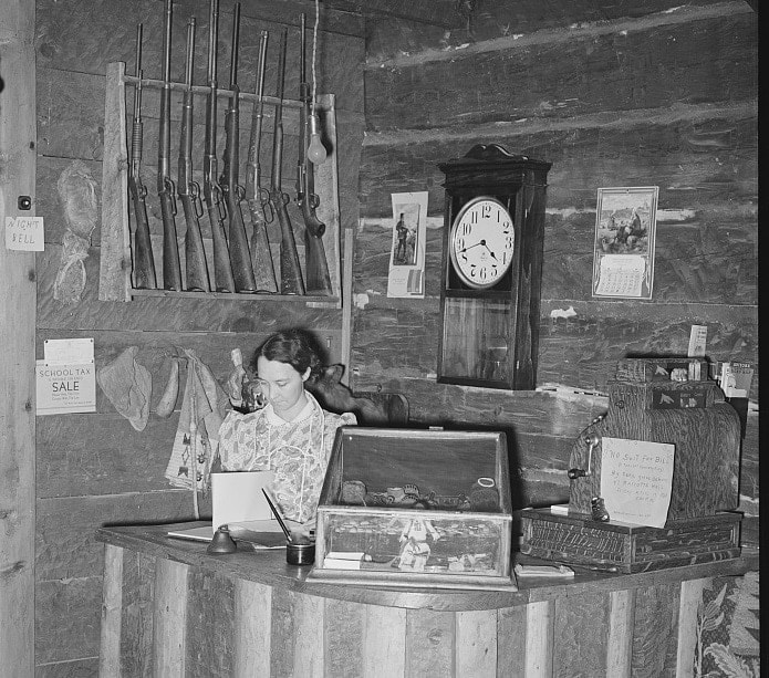 """Manageress of Navajo Lodge at the desk. Datil, New Mexico."""