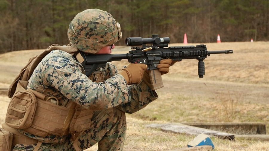 Marine with 1st Battalion, 6th Marines, peers through the Squad Common Optic during a Limited User Evaluation March 2019