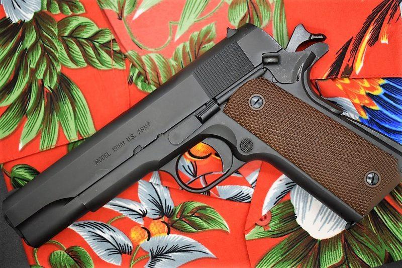 1911 handgun on a Magnum PI hawaiian shirt