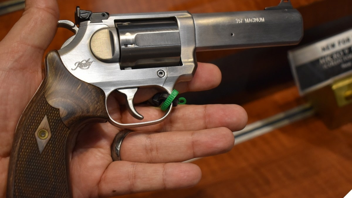 A Kimber 357 Magnum revolver in a large man's well-muscled hand