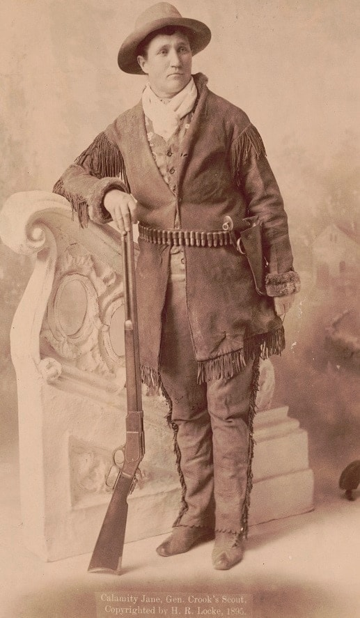 A cabinet portrait of Calamity Jane, Gen. Crook's scout taken in Deadwood SD 1895 Winchester rifle SW revolver LOC