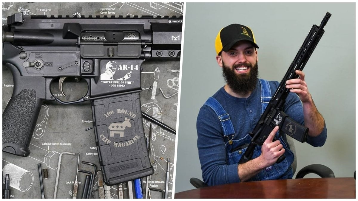 A smiling bearded man holds a new AR-14 rifle with Joe Biden's likeness on it
