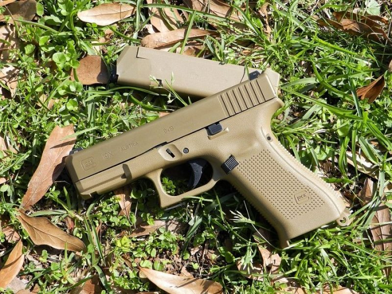 Glock G19X with magazine in a field of green grass