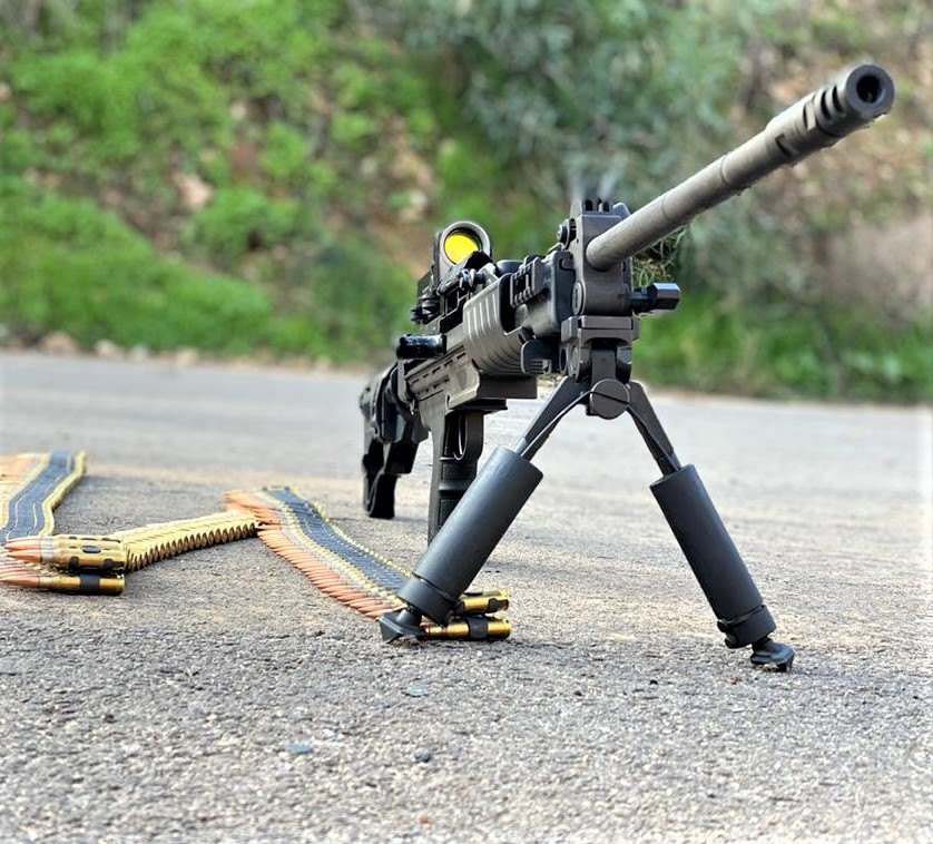 IWI Negev NG7 light machine gun with a belt of 7.62mm NATO ammo attached