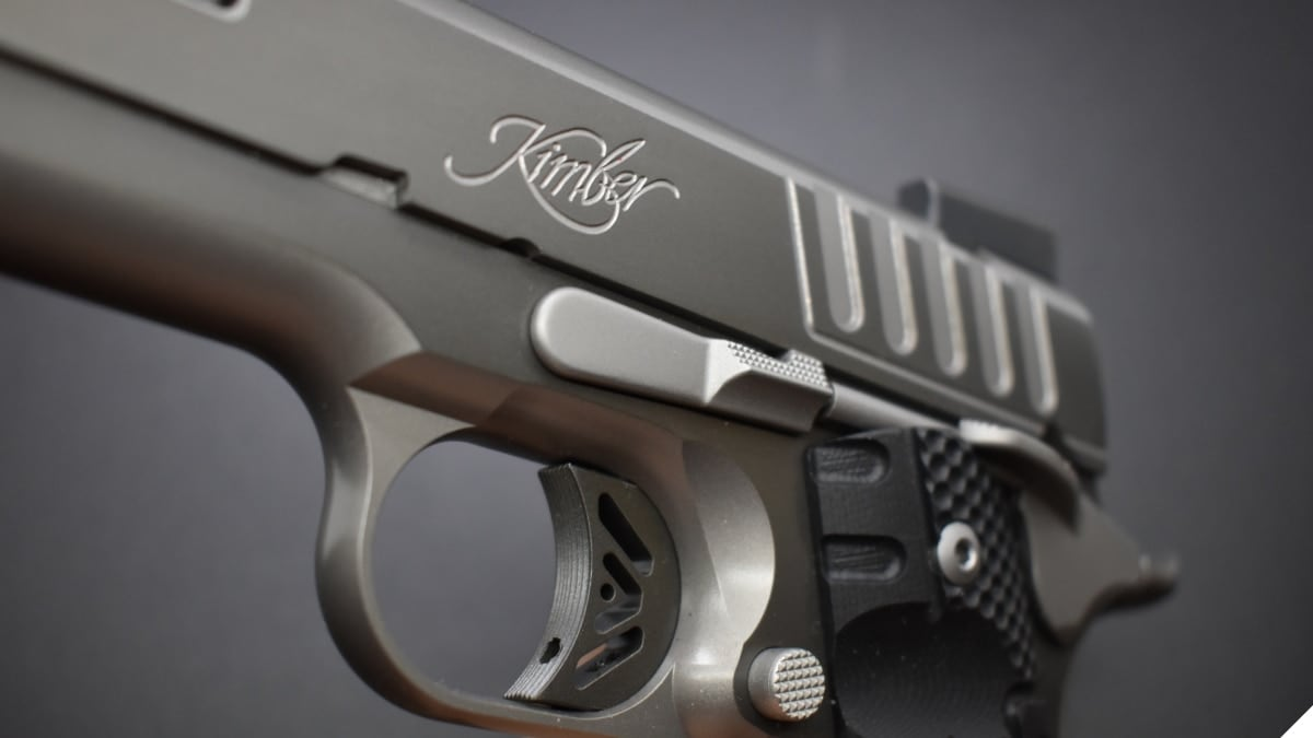 A kimber M1911 pistol showing off the rollmark on the side of the slide