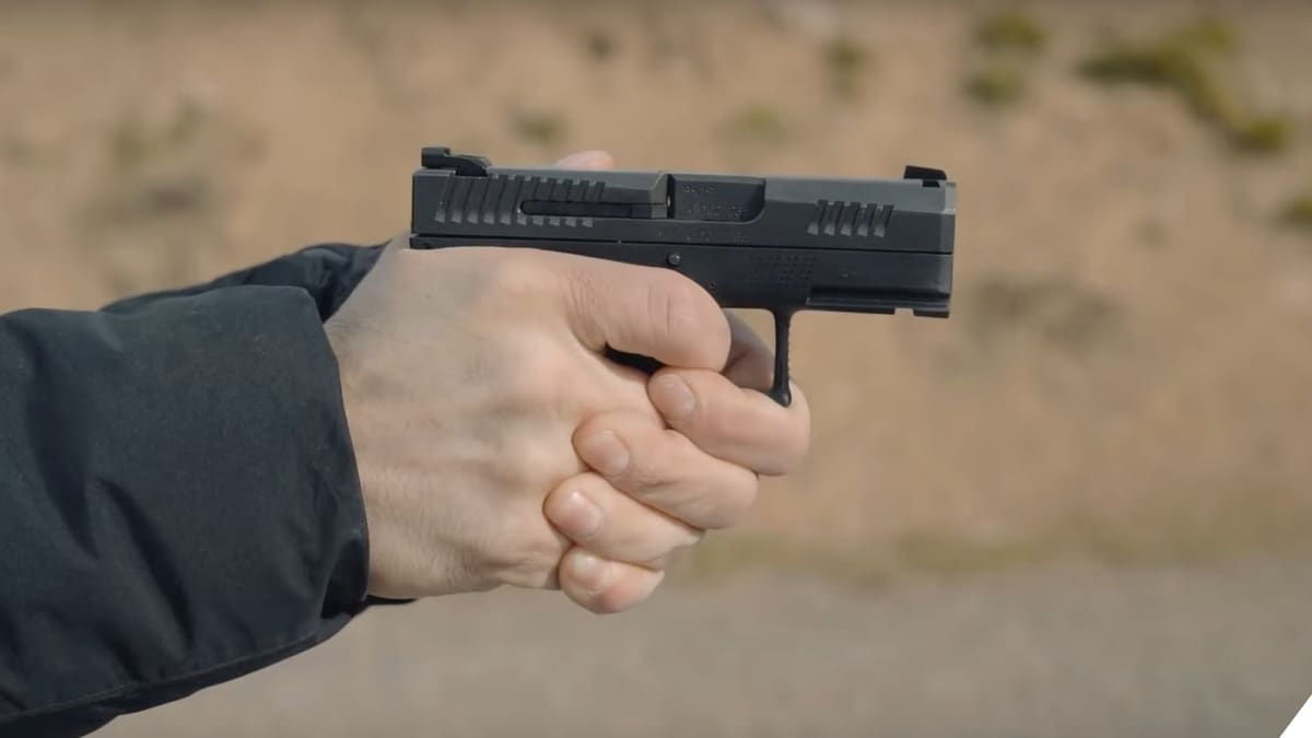 A man holds a new CZ P10M micro compact pistol