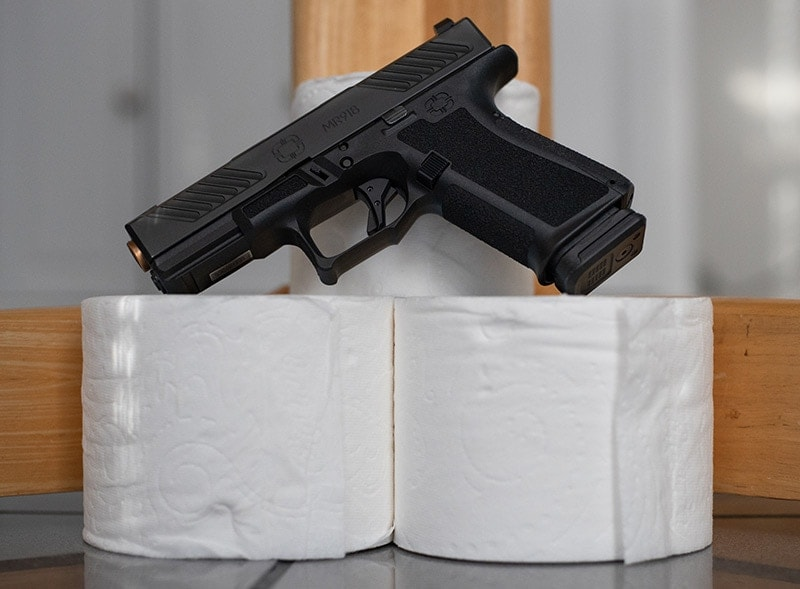 Handgun and toilet paper