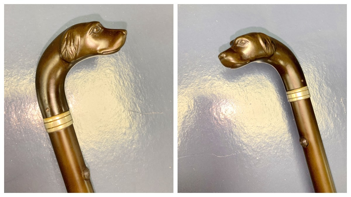 Remington Rifle Cane head, showing two views of a small carved dog head