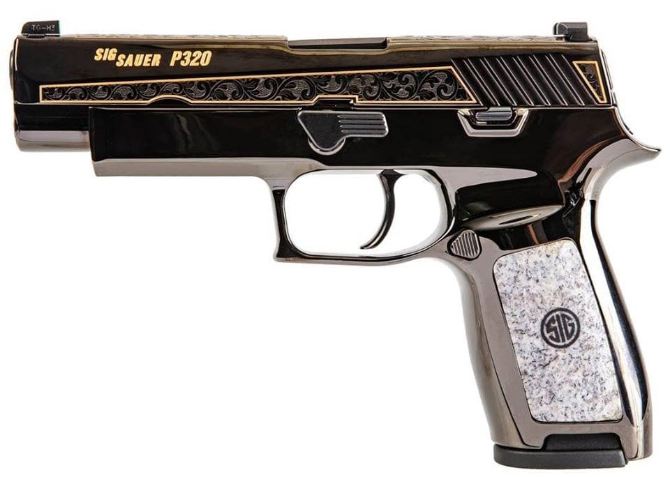 A close up lightbox shot of an engraved Sig Sauer P320 pistol
