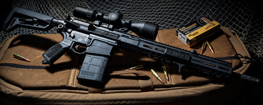 A Sig Sauer 716i rifle rests on a shooting bag
