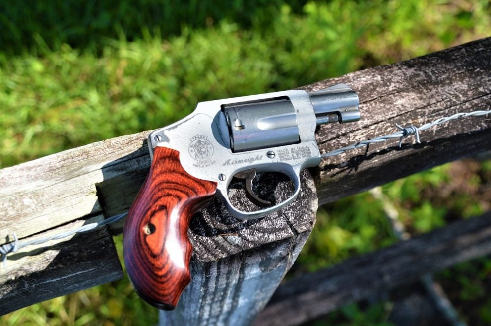 Smith Wesson 642 on a wooden fence