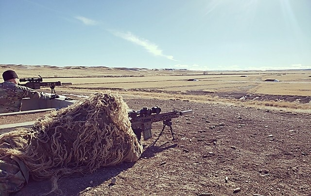 A test Sniper engages targets identified by his spotter while wearing a Ghillie suit during the Compact, Semi-Automatic Sniper Rifle (CSASS) operational test at Fort Carson, Colo. (Photo Credit: Maj. Michael P. Brabner, Test Officer, Maneuver Test Directorate, U.S. Operational Test Command)