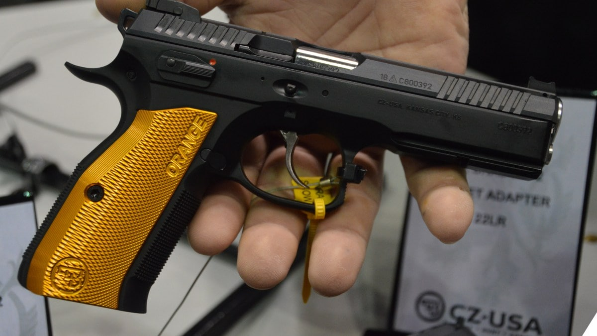 A CZ pistol is shown held by a man