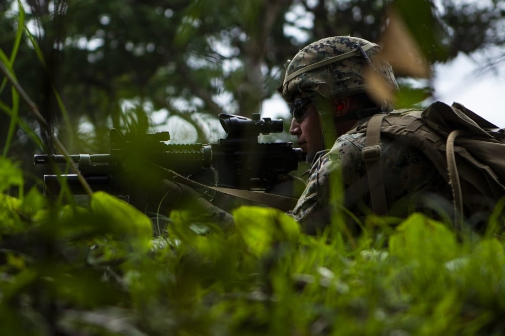 "Cpl. Daniel Collacott, a rifleman with Charlie Company, Battalion Landing Team, 1st Battalion, 4th Marines, holds security during platoon attack training at Camp Schwab, Okinawa, Japan, Feb. 28, 2019. Collacott, a native of Colorado Springs, graduated from Discovery Canyon High School in May 2014 before enlisting in June 2015. During the training, Marines with Charlie Company refined their ability ""To locate, close with and destroy the enemy by fire and maneuver, or repel the enemy's assault by fire and close combat,"" the mission of the Marine Corps rifle squad. Charlie Company Marines are the airborne raid specialists with BLT 1/4, the Ground Combat Element for the 31st Marine Expeditionary Unit. The 31st MEU, the Marine Corps' only continuously forward-deployed MEU, provides a flexible and lethal force ready to perform a wide range of military operations as the premier crisis response force in the Indo-Pacific region. (U.S. Marine Corps photo by Gunnery Sgt. T. T. Parish/Released)"