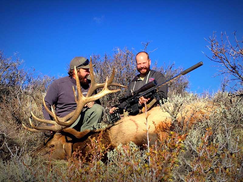 Hunters with elk