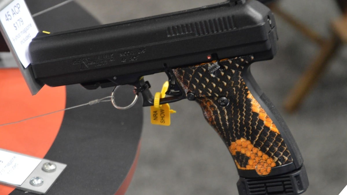 A Hi-Point JHP 45 pistol with snakeskin grips