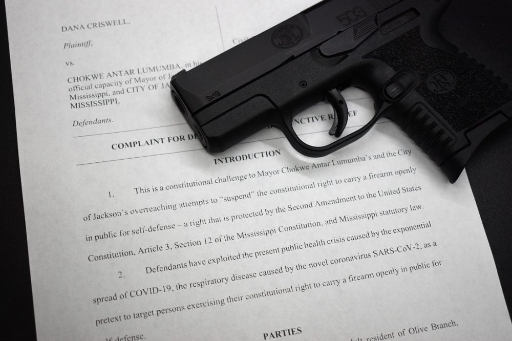 A lawsuit over the right to keep and bear arms with an FN 503 pistol on top