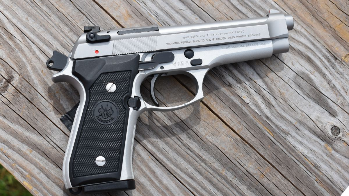A Beretta 92F Inox stainless on a wooden table