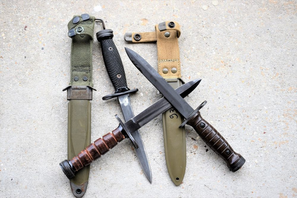 The M1 Carbine used the M4 bayonet, with a distinctive small barrel mount ring on the crossguard. Shown are U.S-, Japanese and Italian-made variants. (Photo: Chris Eger/Guns.com)