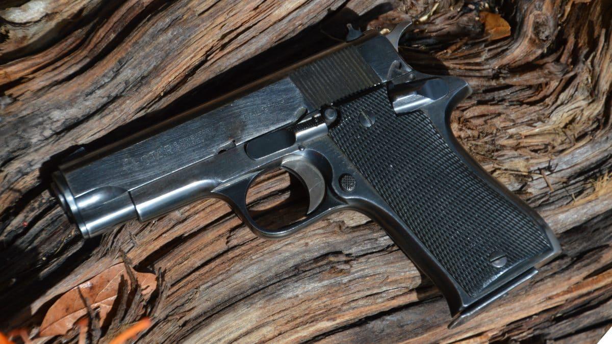 A Star BM 9mm handgun on a driftwood plank